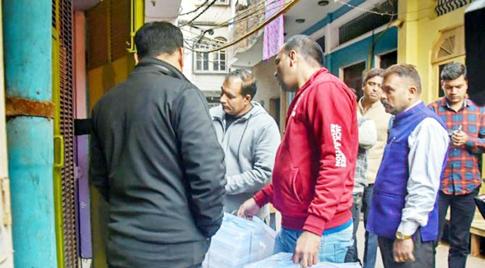NIA and Delhi Police officials during a search operation at Jaffrabad, North East district in Delhi on Wednesday.
