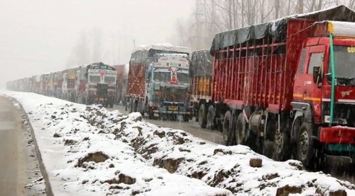 Stranded trucks near Qazigund in Kashmir on Thursday. -Excelsior/Sajjad Dar