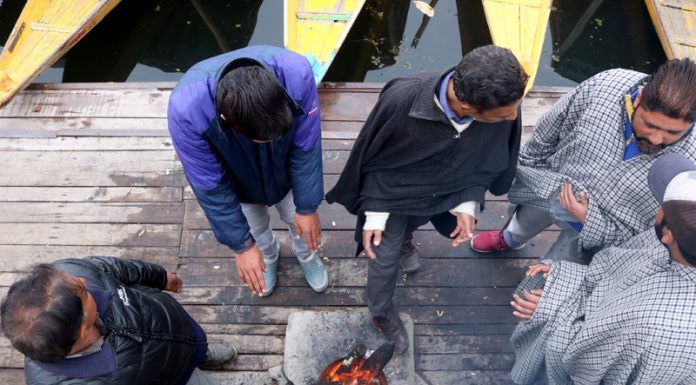 People warm themselves on a cold winter day in Srinagar. —Excelsior/Shakeel
