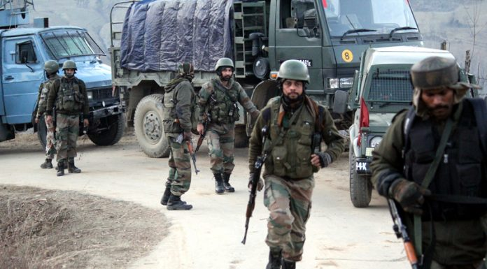Troops patrol Dandmuh village of Chadoosa in Baramulla after a militant attack on Sunday. —Excelsior/Aabid Nabi