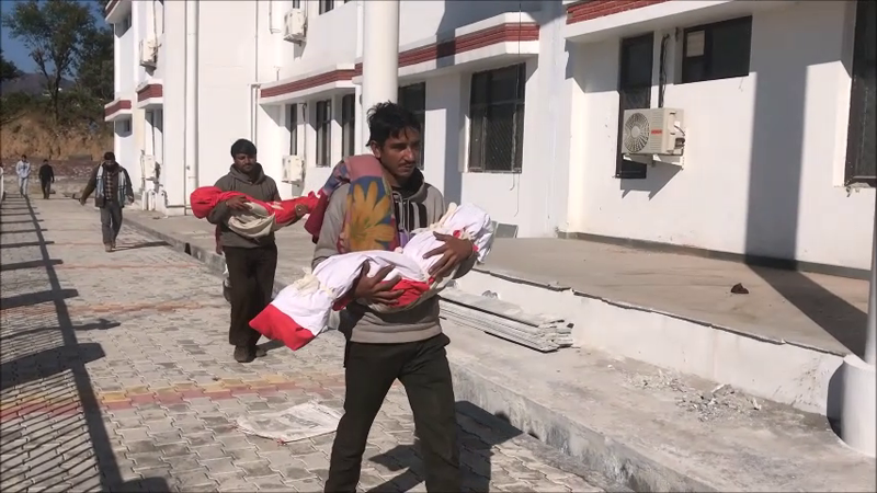 Family members carrying dead bodies of two minor sisters, who dies because of unknown disease in Reasi district on Saturday.