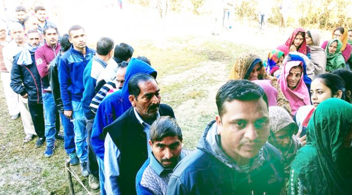 People waiting for their turn to cast vote at a polling station in Udhampur on Saturday. —Excelsior/Pawan Gupta