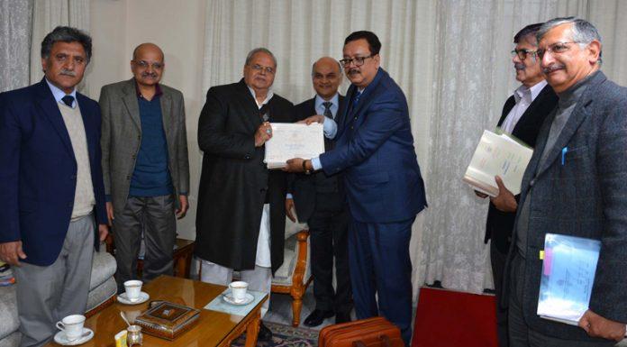 Finance Secretary Navin Choudhary presenting budget to Governor Satya Pal Malik during SAC meeting in Jammu on Saturday.