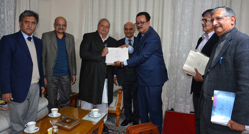 Finance Secretary Navin Choudhary presenting budget to Governor Satya Pal Malik during SAC meeting in Jammu on Saturday.