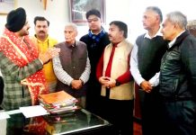Chief Executive Officer of Shri Mata Vaishno Devi Shrine Board, Simrandeep Singh interacting with a deputation at Katra on Tuesday.