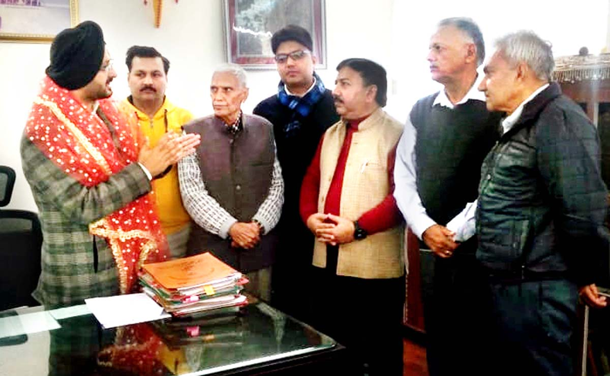 Chief Executive Officer of Shri Mata Vaishno Devi Shrine Board, Simrandeep Singh interacting with a deputation at Katra on Tuesday.