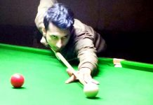 A cueist aiming at target during Six Red Ball match at Billiards Hall, MA Stadium Jammu on Thursday. -Excelsior/Rakesh