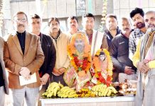 Director Agriculture, Jammu, H.K Razdan along with his staff during installation of the idol of Baba Jitto at Krishi Bhawan, Talab Tillo on Friday.