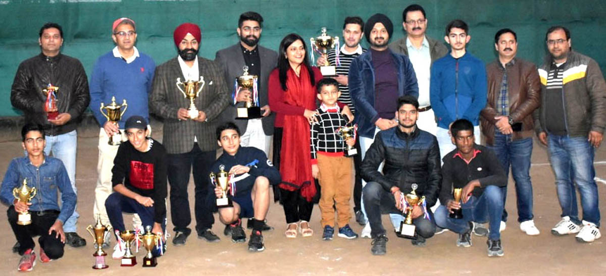 Winners of State Lawn Tennis Championship and dignitaries posing for group photograph at Jammu on Sunday.