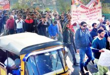 Aggrieved KAS aspirants taking out protest march at Jammu on Tuesday.