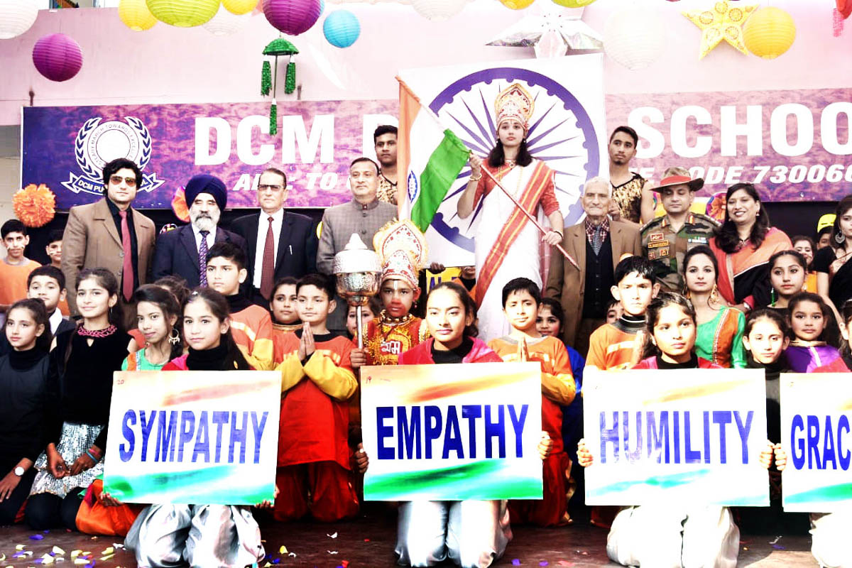 Students displaying placards while celebrating Annual Day at DCM Public School in Jammu.