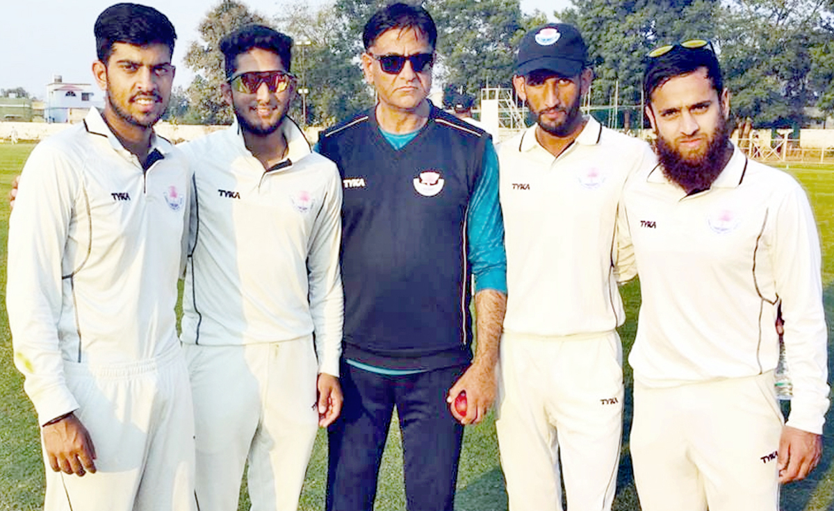From (L) Suryansh Raina, Shubham Singh Pundir, Abhishant Bakshi and Muneeb Munaf posing along with Manager Nisar Ahmed (C) on Tuesday.