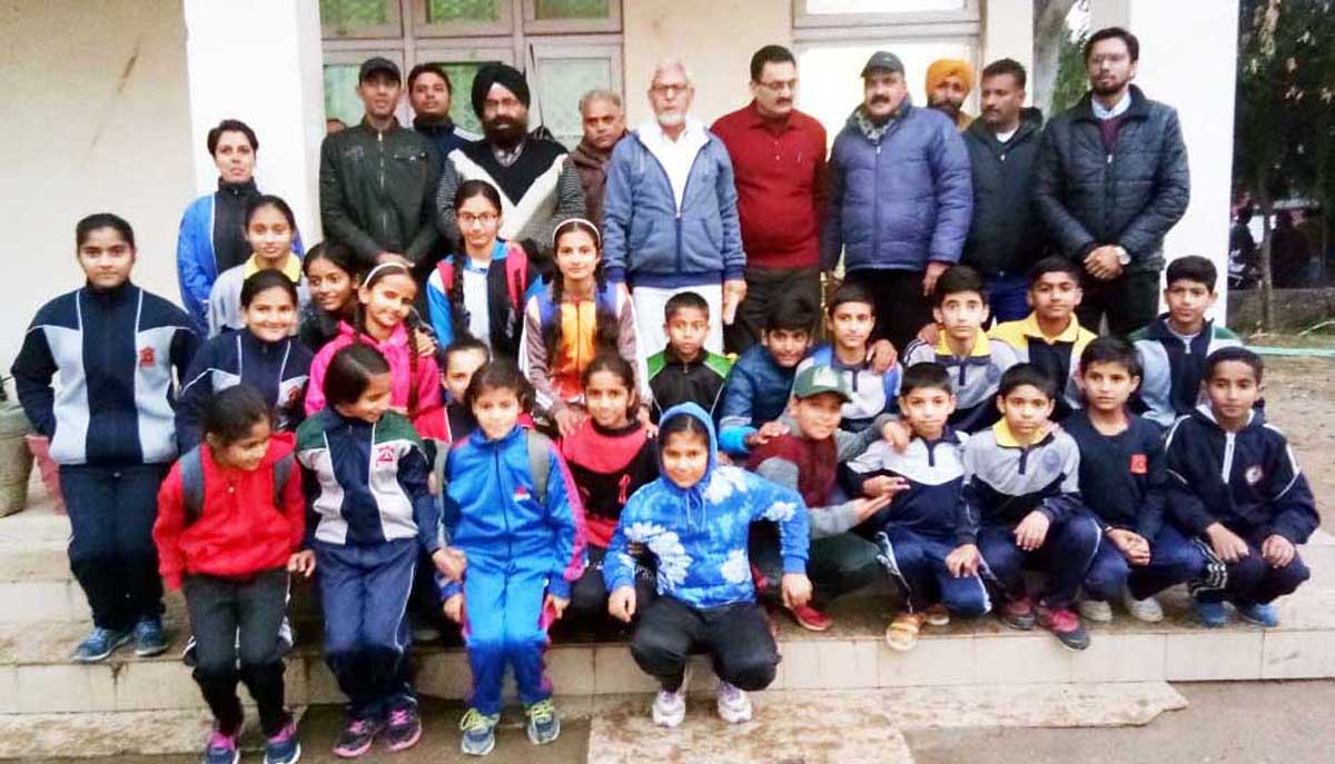 Selected players and dignitaries posing for group photograph at Jammu on Monday.
