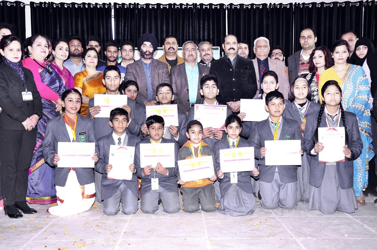Students posing for photograph after being honoured by the dignitaries at newly opened Indoor Sports Arena by IDPS at Sunjwan Jammu.