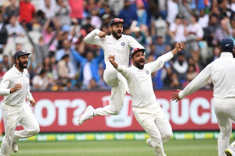 Captain Virat Kohli, Pujara and Rahane celebrate after winning the third test match against Australia at the MCG in Melbourne.