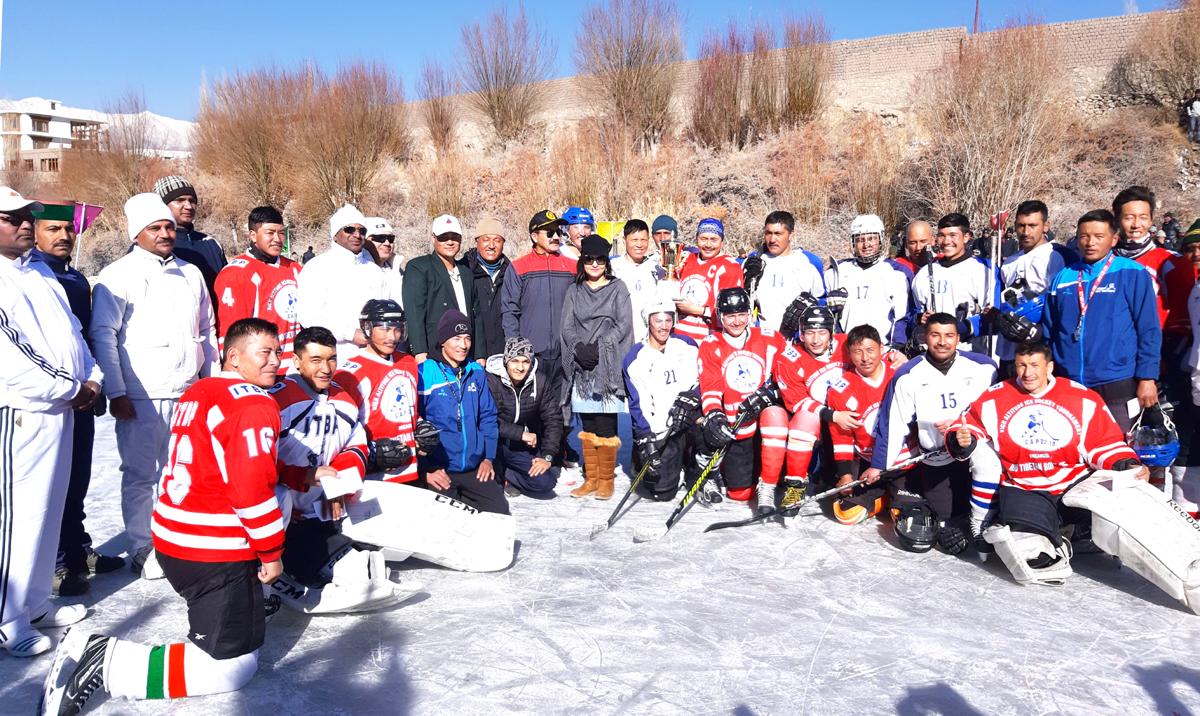 Winners of Ice Hockey exhibition match posing along with dignitaries and officials in Leh on Sunday. -Excelsior/ Morup Stanzin
