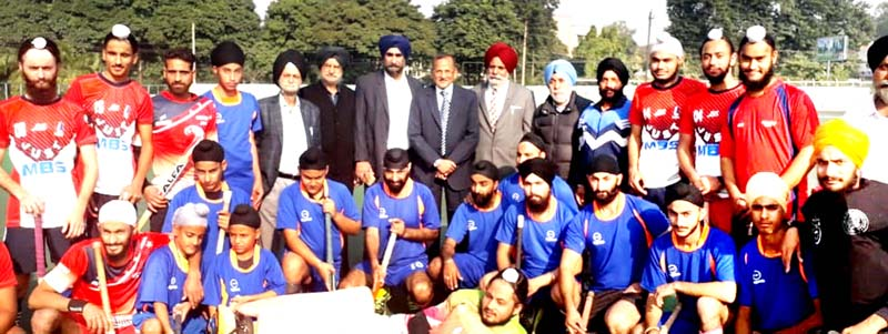 Winning teams posing for a group photograph with guests and other dignitaries.