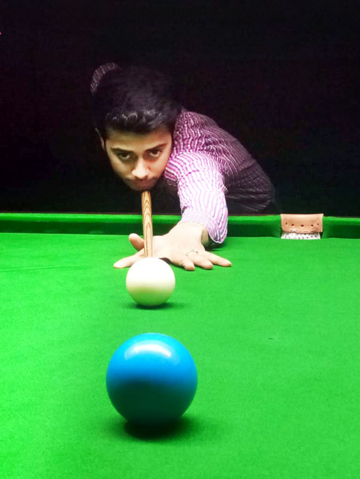 A cueist aiming at target during Six Red Ball match at Billiards Hall, MA Stadium Jammu on Sunday. -Excelsior/Rakesh