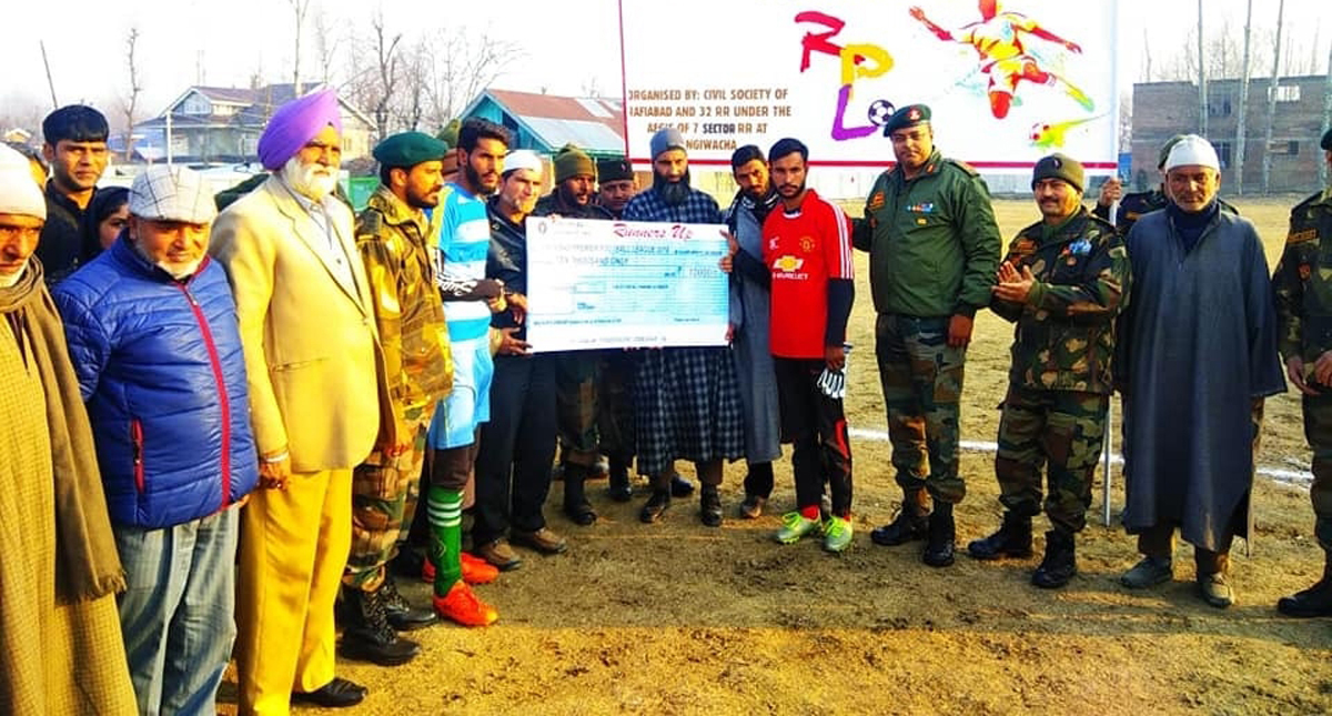 Winners being felicitated by the dignitaries during the concluding ceremony of Rafiabad Football Tournament in Baramulla. — Excelsior/Abid Nabi