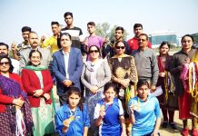 Winners of Inter-District Athletics Meet posing along with chief guest and other dignitaries at Jammu University in Jammu.