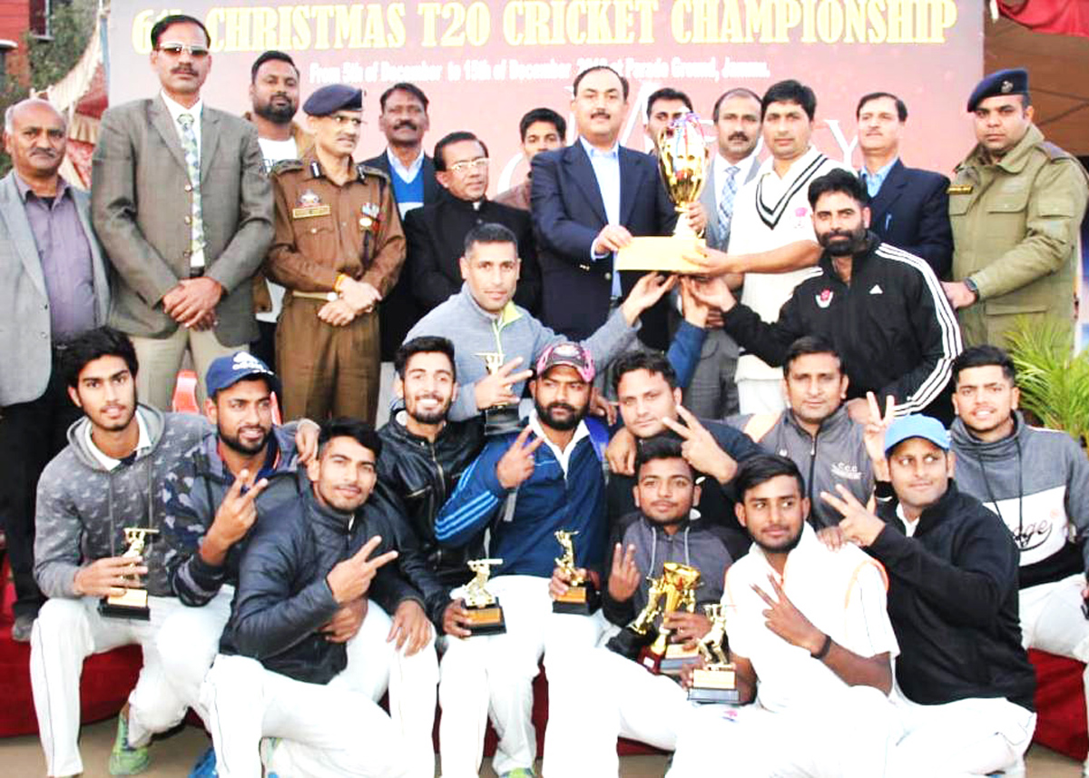 IGP Jammu Zone Dr SD Singh presenting the title trophy of the 6th Christmas T20 Championship to winner team at Jammu on Sunday.