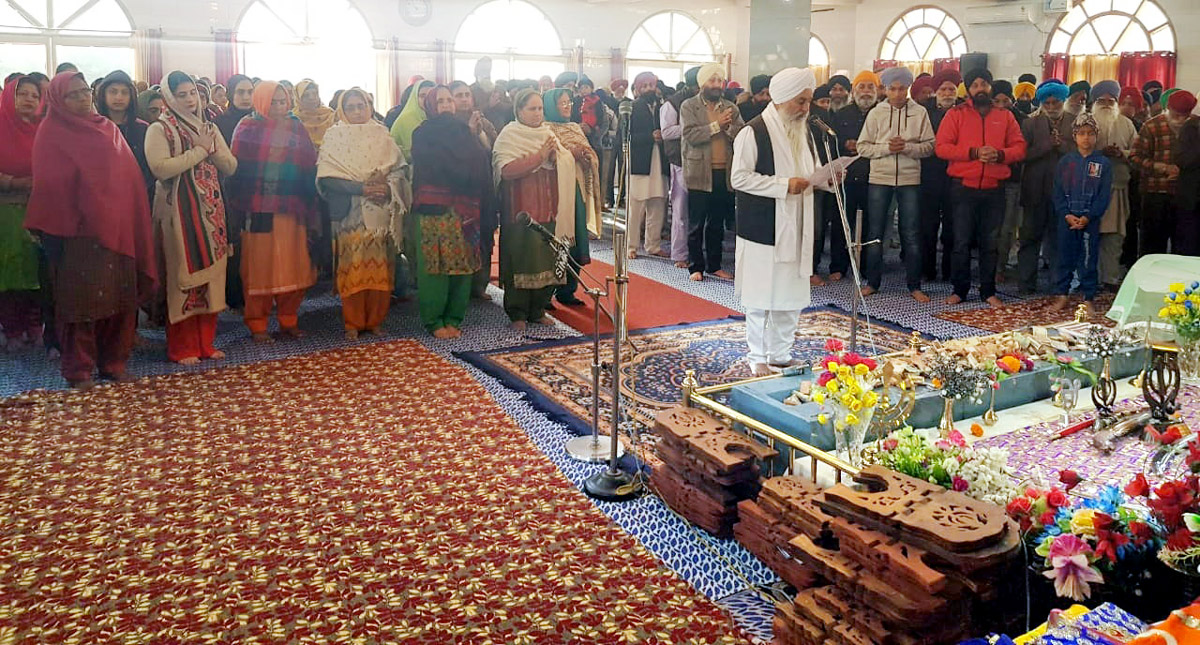 Sikh devotees performing 'Sehaj Paath' at Digiana Ashram in Jammu.