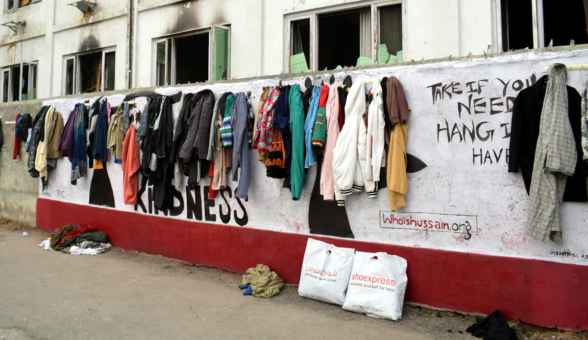 'Wall of kindness' in Srinagar. -Excelsior/Shakeel