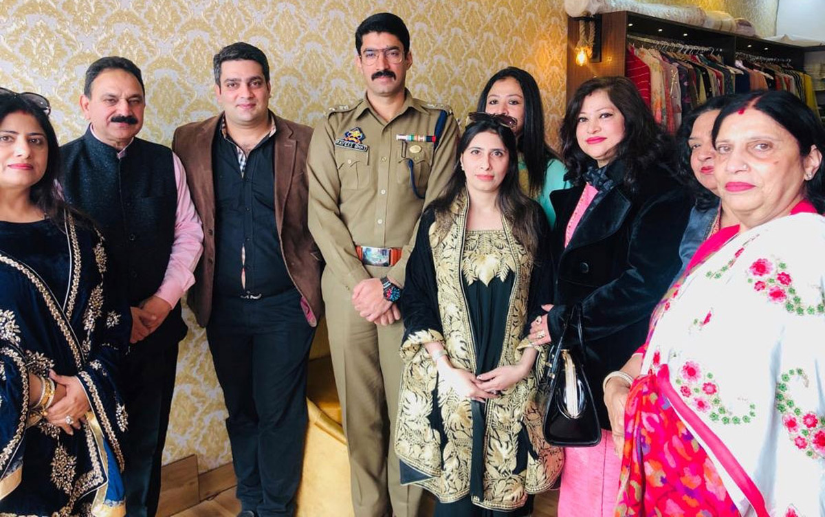 SSP Udhampur, Rayees Bhat posing along with other guests in newly opened designer wear showroom at Udhampur.