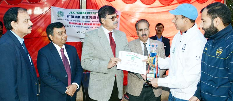 Advisor Vijay Kumar honouring sportspersons of Forest Department in Jammu.
