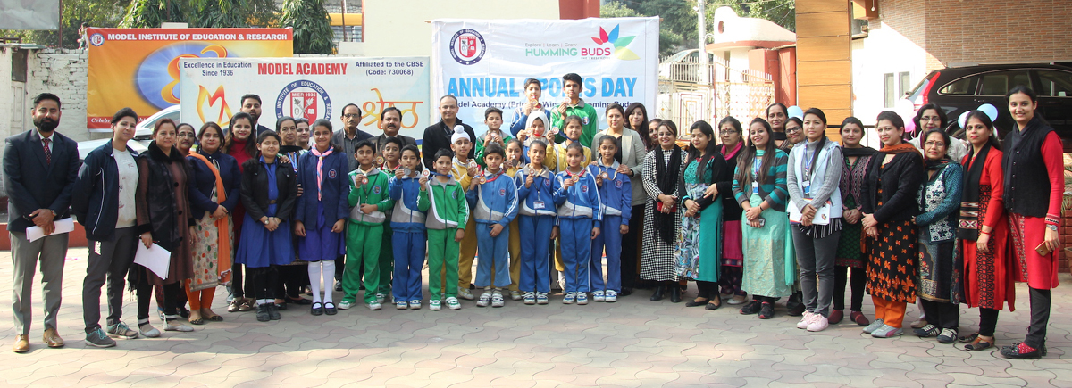 Children posing along with dignitaries and officials while celebrating Sports Day at Model Academy in Jammu.