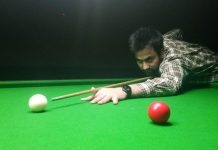 Cueist aiming at target during Senior Snooker Championship in Jammu on Monday.
