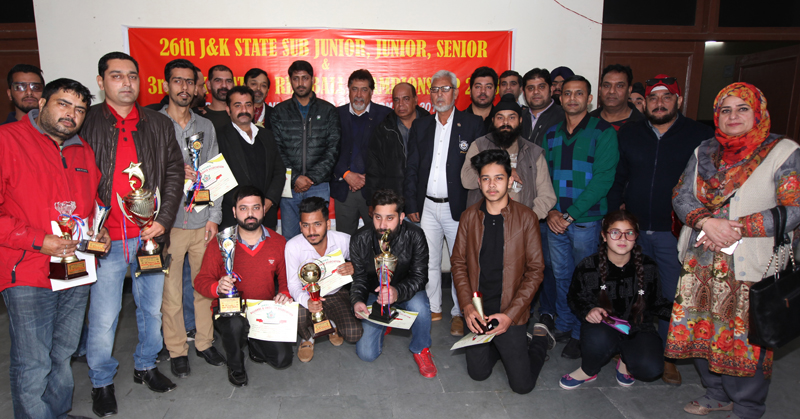 Winners and runner-ups of 26th J&K State Billiards and Snooker Championship and dignitaries posing for group photograph at Billiards Hall, MA Stadium Jammu on Tuesday. — Excelsior/Rakesh