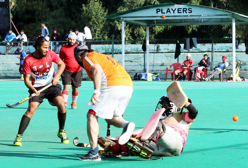 Players in action during a match of 1st Chaar Sahibzade Hockey Tournament in Jammu on Wednesday. -Excelsior/Rakesh