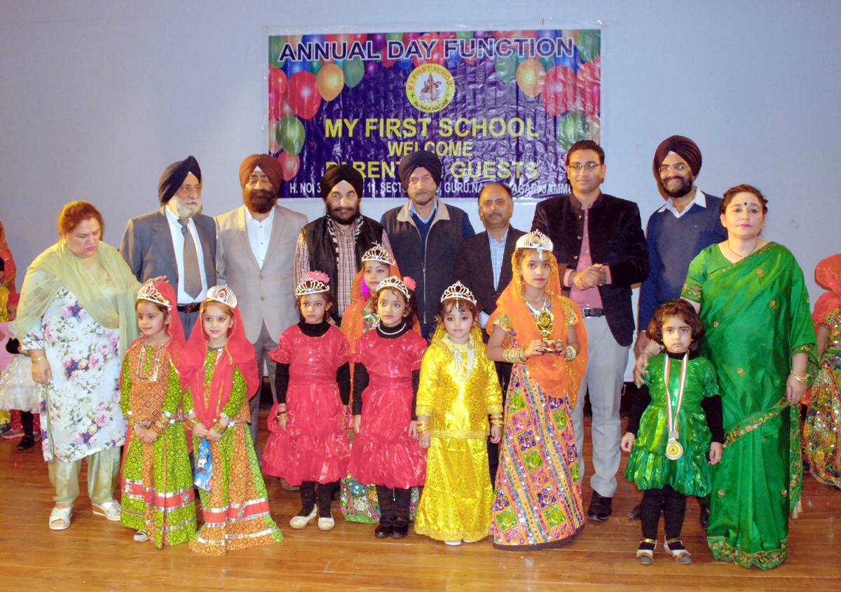 Children in colourful attires posing alongwith school managements at MFS Guru Nanak Nagar in Jammu.