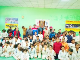 Judokas posing along with chief guest and other dignitaries during inaugural ceremony of Jammu District Judo Championship in Jammu.