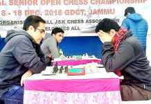 Chess players busy in making moves during Senior National Chess Championship at Jammu on Saturday. -Excelsior/Rakesh