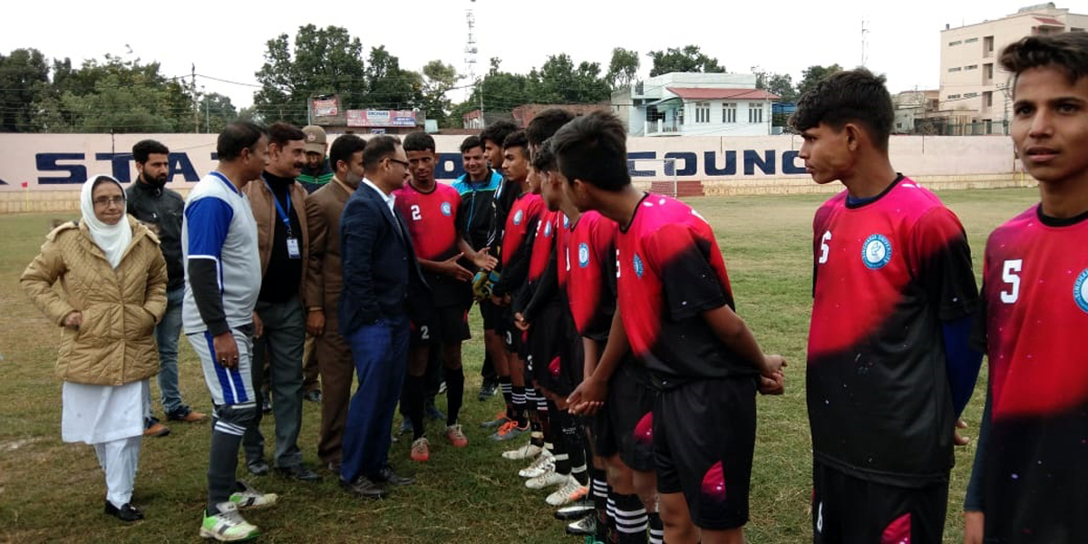 DYSS officials interacting with players at Mini Stadium Parade.