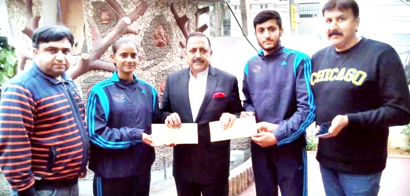 Union Minister, Dr Jitendra Singh handing over an amount of Rs 25000 each to two sports persons at Jammu on Monday.