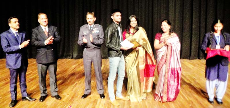 A student being felicitated during Annual Day celebration.