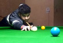 A cueist aiming at target during Six Red Ball match at Billiards Hall, MA Stadium Jammu on Tuesday. — Excelsior/Rakesh