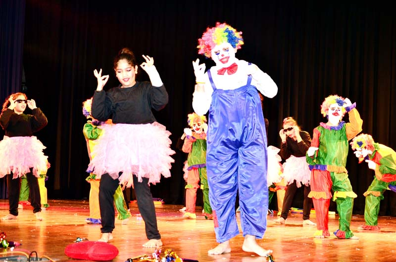 Children performing dance item in colourful attires at Sprawling Buds School Bantalab in Jammu.