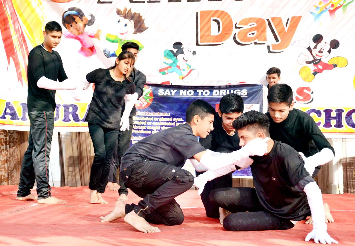 Students presenting cultural item during Annual Day function.