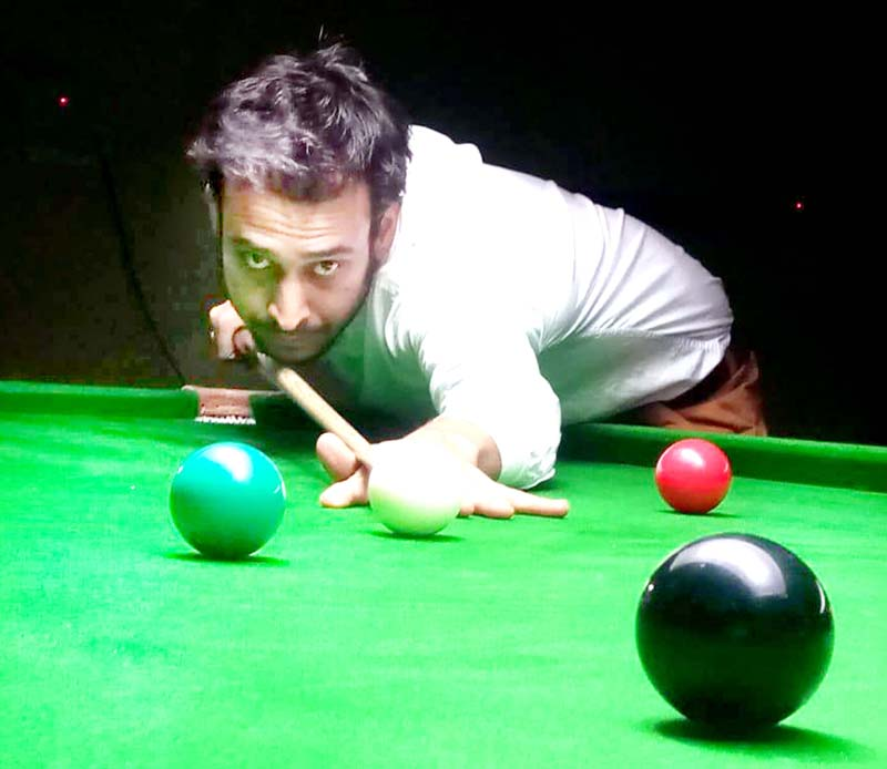 A cueist in action during Six Red Ball match at Billiards Hall, MA Stadium Jammu on Saturday. -Excelsior/Rakesh