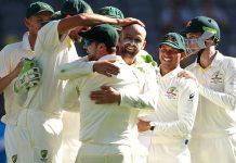 Australian team celebrating dismissal of Virat Kohli.