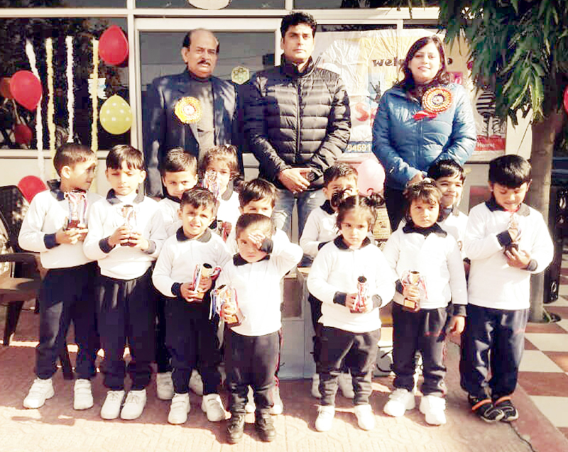 Children posing along with dignatries during Annual Sports Day at Kids Campus on Thursday.