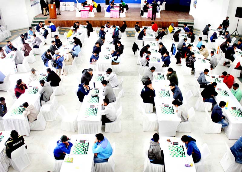 Players in action during Senior National Open Chess Championship in Jammu. -Excelsior/Rakesh