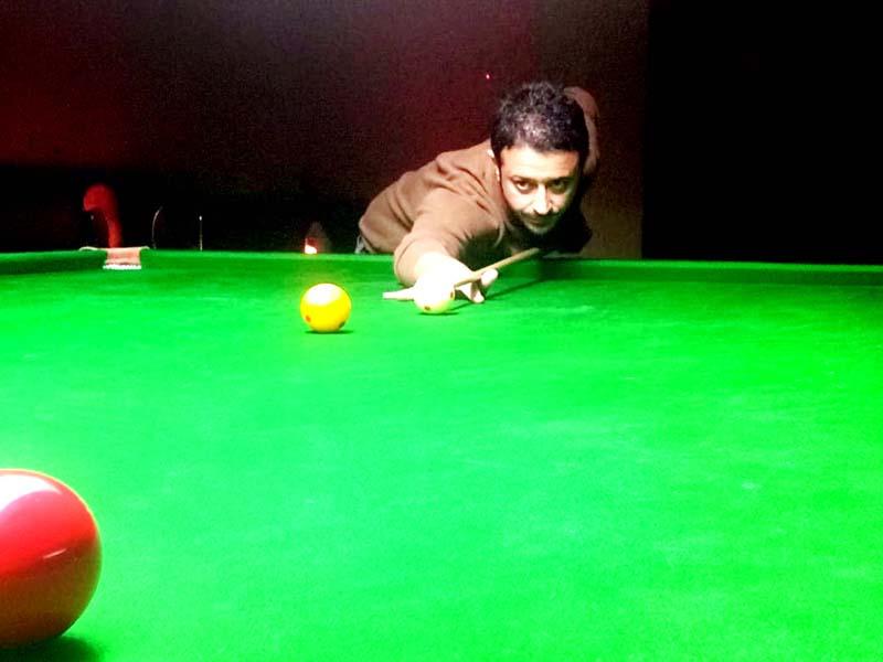 Cueist Nikhil Kapahi in action during Senior Billiards Championship at Billiards Hall, MA Stadium in Jammu.