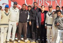 Winner team players and dignitaries posing for group photograph at Jammu on Friday.