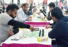 Chess players busy in making moves during Senior National Chess Championship at Jammu on Friday. —Excelsior/Rakesh