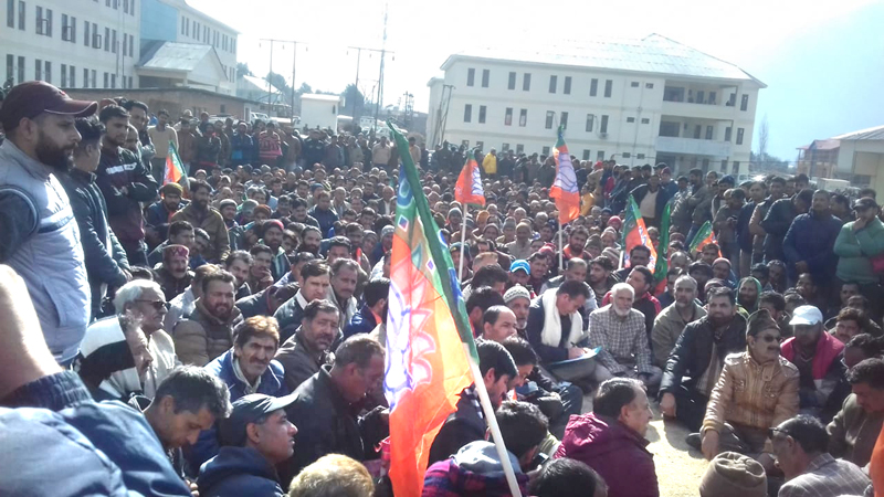 BJP members protesting at Kishtwar against failure of administration to arrest assailants involved in Parihar brothers killing on Thursday.